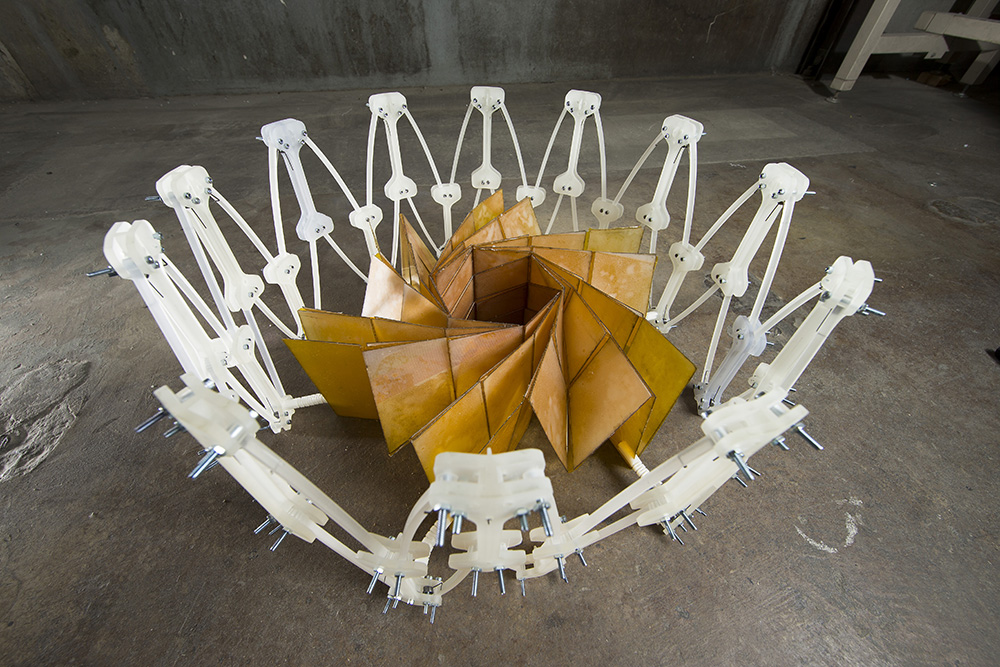 Researchers at NASA's Jet Propulsion Laboratory, Pasadena, California, and Brigham Young University, Provo, Utah, collaborated to construct a prototype of a solar panel array that folds up in the style of origami, to make for easier deployment. Image Credit: BYU Photo 2014